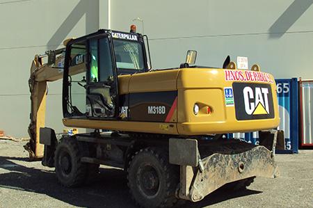 Retroexcavadora de ruedas CAT 318